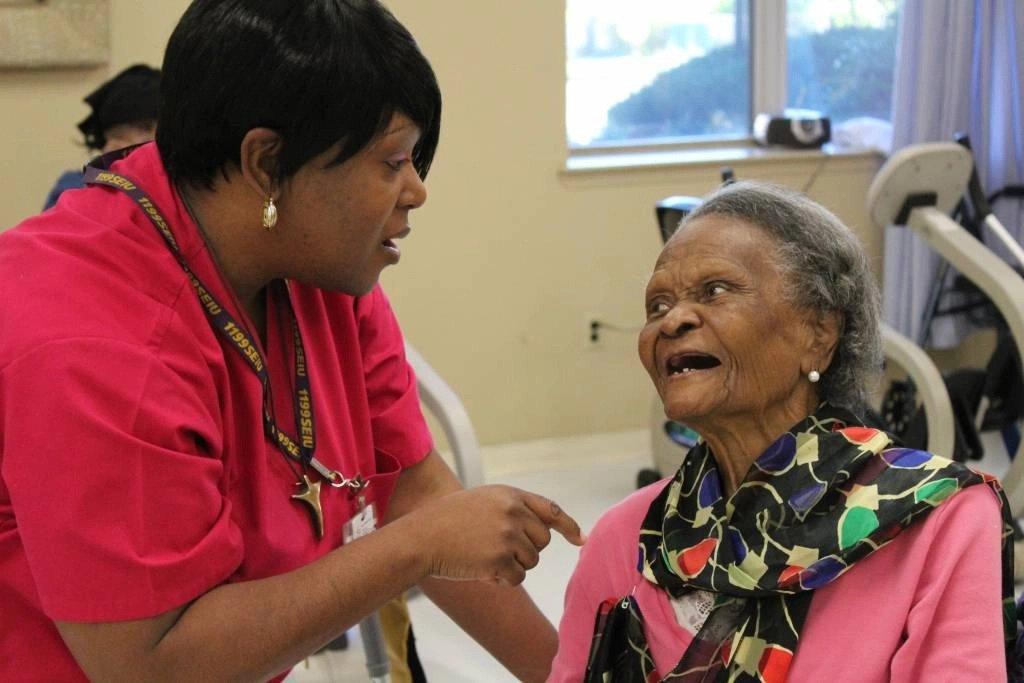 Nurse smiling at patient